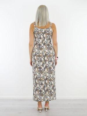 cirkelprint-jurk-van-travelstof-met-spaghettibandjes-in-wit-van-angelle-milan