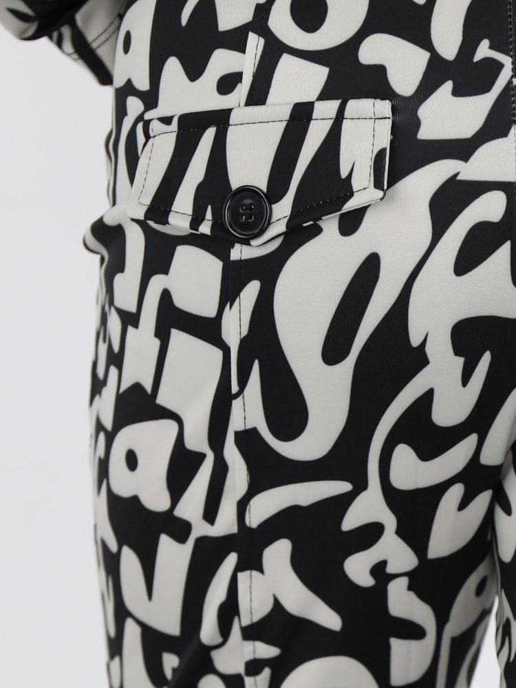 angelle-milan-broek-van-travelstof-in-licht-beige-met-zwarte-print-abstract