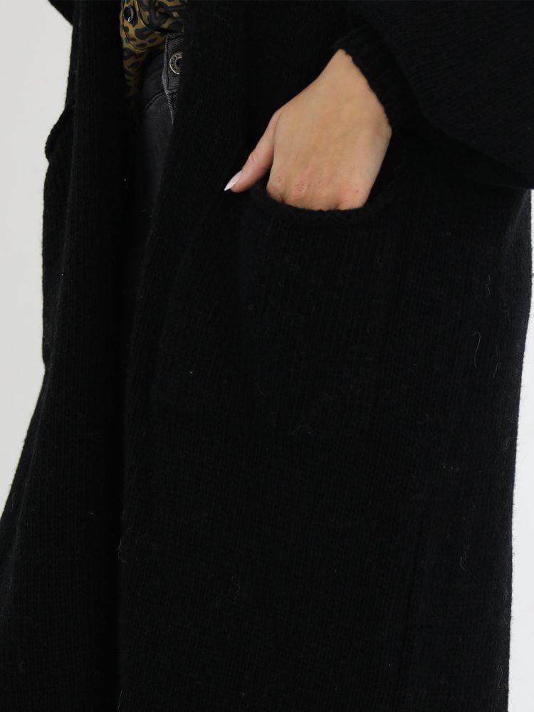 g-ricceri-vest-lang-model-in-een-zwarte-kleur-met-ballonmouwen-en-zakken